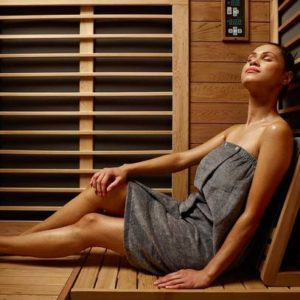Woman in an infrared sauna