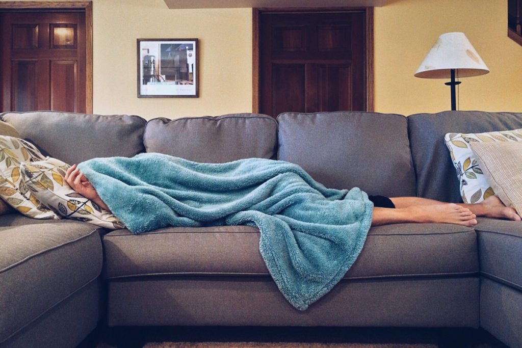 Woman on couch with a cold